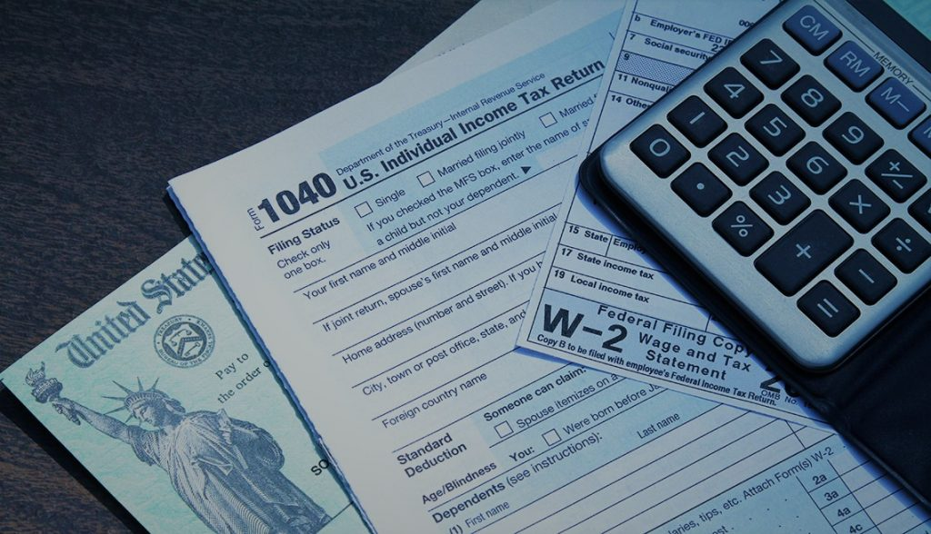Tax forms and a U.S. Treasury check